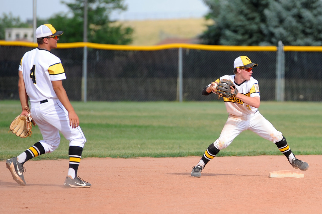 . Second baseman Jarret Riehl turns a double play next to shortstop Cameron Nellor during Thompson Valley\'s game Thursday, July 20, 2018 at Constantz Field. (Sean Star/Loveland Reporter-Herald)