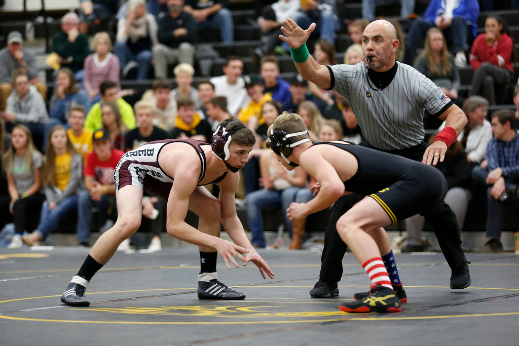. The ref calls the 138 weight class match to a start with Berthoud�s Brock Leypoldt against Thompson Valley�s Trent Suppes on Wednesday, Nov. 29, 2017, at the Thompson Valley gym in Loveland. (Photo by Lauren Cordova/Loveland Reporter-Herald)