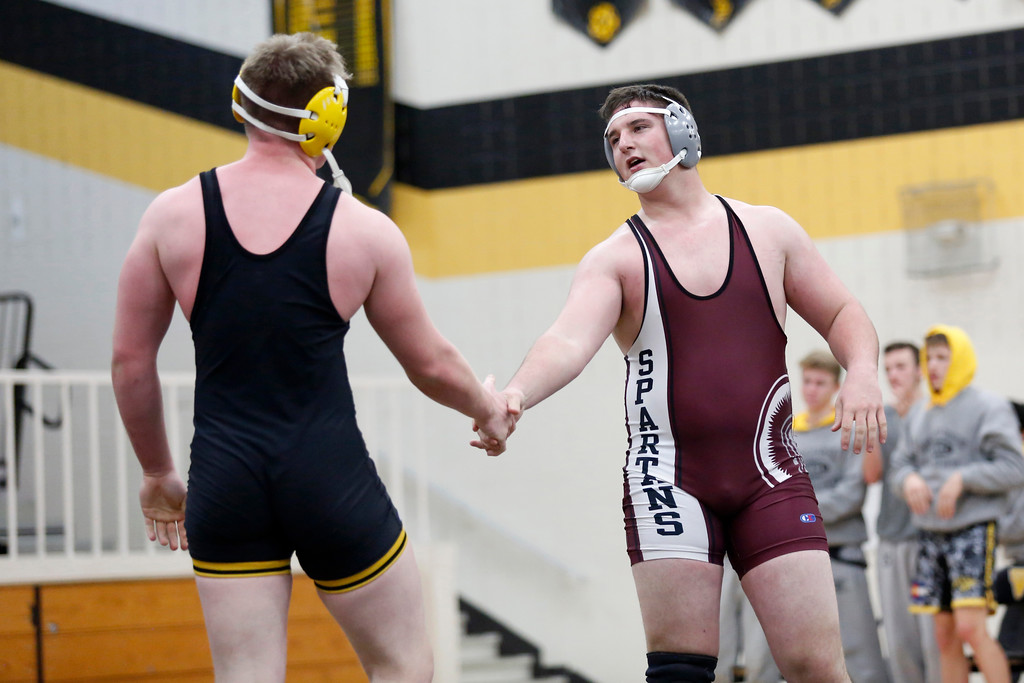 . Berthoud�s heavy weight winner Connor Balliet shakes Thompson Valley�s Chris Ringus� hand after their match on Wednesday, Nov. 29, 2017, at the Thompson Valley gym in Loveland. (Photo by Lauren Cordova/Loveland Reporter-Herald)