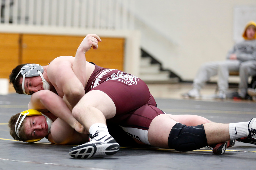 . Berthoud�s Connor Balliet pins down Thompson Valley�s Chris Ringus during their match in the heavy weight class on Wednesday, Nov. 29, 2017, at the Thompson Valley gym in Loveland. (Photo by Lauren Cordova/Loveland Reporter-Herald)