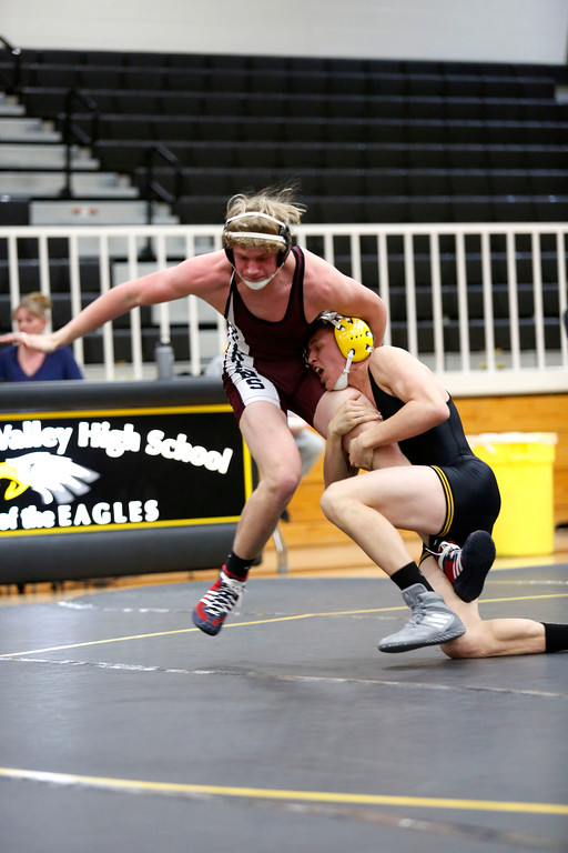 . Thompson Valley�s Hunter Williams tries to take down Berthoud�s Wyatt Larson during their 170 weight class match on Wednesday, Nov. 29, 2017, at the Thompson Valley gym in Loveland. (Photo by Lauren Cordova/Loveland Reporter-Herald)