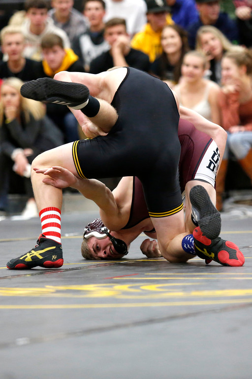. Thompson Valley�s Trent Suppes gets a hold on Berthoud�s Brock Leypoldt buring their 138 weight class match on Wednesday, Nov. 29, 2017, at the Thompson Valley gym in Loveland. (Photo by Lauren Cordova/Loveland Reporter-Herald)