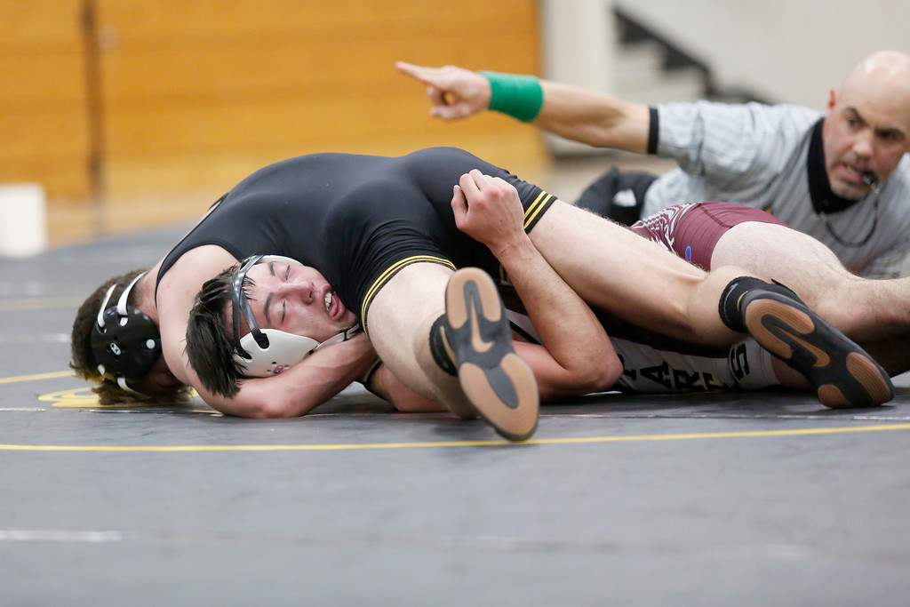 . Thompson Valley�s Chase Englehardt pins down Berthoud�s Tristen Workman to win their 160 weight class match on Wednesday, Nov. 29, 2017, at the Thompson Valley gym in Loveland. (Photo by Lauren Cordova/Loveland Reporter-Herald)