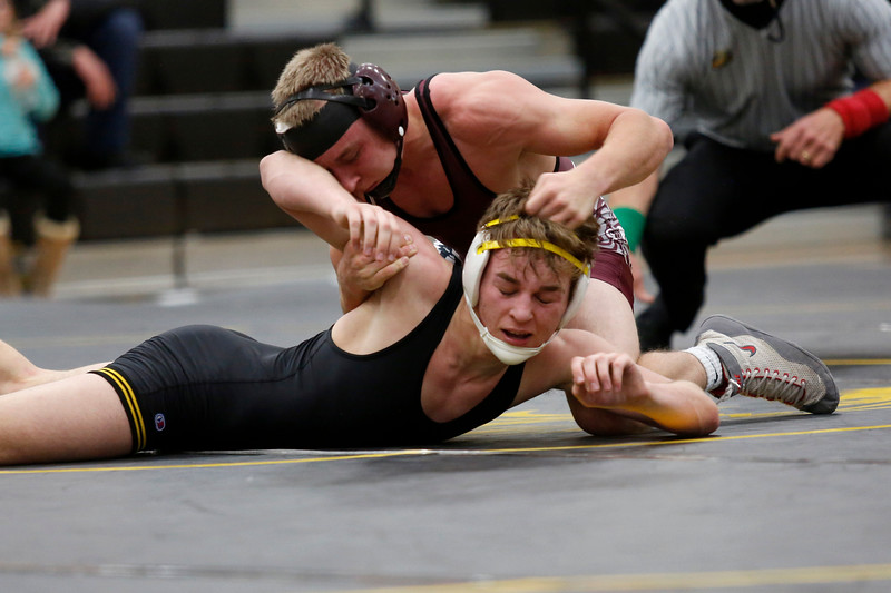 Berthoud's Austyn Binkly pins down Thompson Valley's Jay Mclaughlin during their 145 weight class match on Wednesday, Nov. 29, 2017, at the Thompson Valley gym in Loveland. (Photo by Lauren Cordova/Loveland Reporter-Herald)