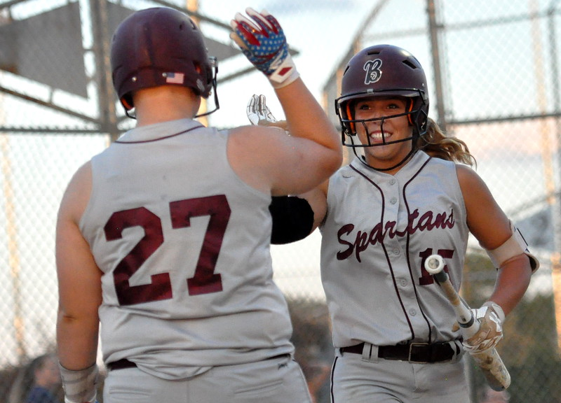 Berthoud's Addison Spears (15) high fives Ashlynn Balliet (27) after scoring against Thompson Valley on Friday Aug. 25, 2017 at Centennial Park. The Spartans won 17-6. (Cris Tiller / Loveland Reporter-Herald)
