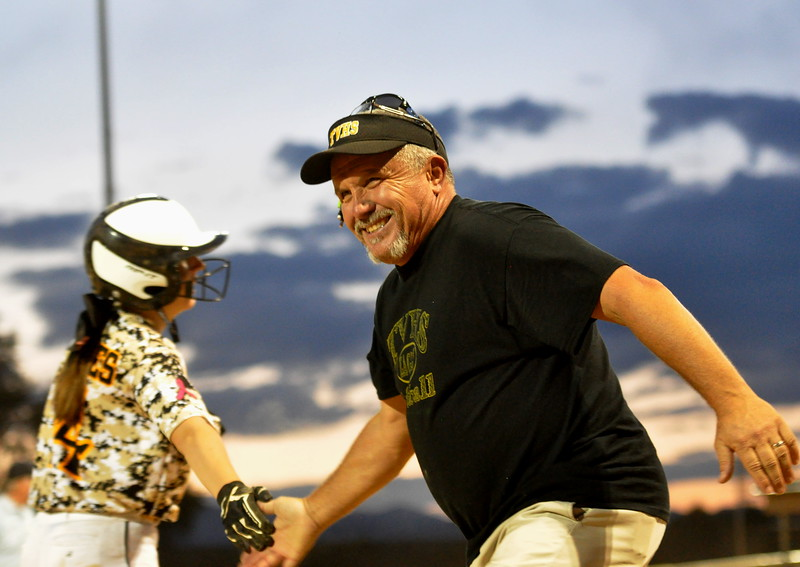 Thompson Valley coach Bryon Rutherford smiles and high fives Autumn Porter after the Eagles scored a run against Berthoud on Friday Aug. 25, 2017 at Centennial Park. (Cris Tiller / Loveland Reporter-Herald)