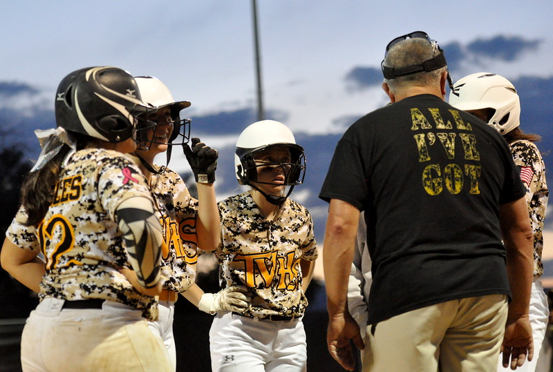 Thompson Valley players meet with coach Bryon Rutherford at third base Friday Aug. 25, 2017 at Centennial Park. (Cris Tiller / Loveland Reporter-Herald)