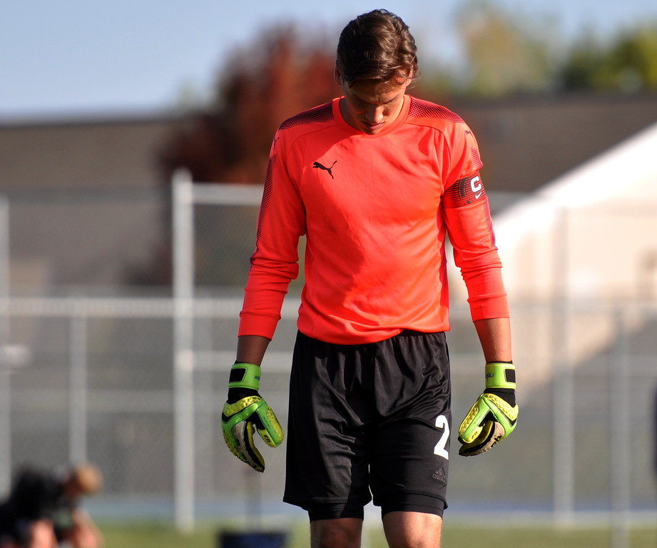 Mountain View goalkeeper Zach Eastman looks down in frustration after a Thompson Valley goal on Tuesday Oct. 3, 2017 at MVHS. (Cris Tiller / Loveland Reporter-Herald)