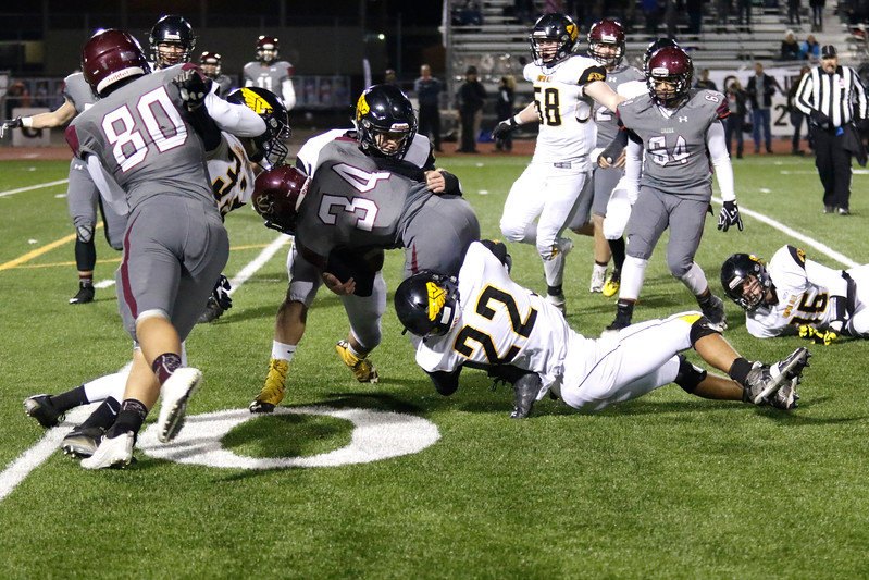 Thompson Valley's Rocky Guy (22) and Caleb Burton (24) tackle Silver Creek's Andreik Knechtel (34) just before the 10-yard line on Thursday, Nov. 2, 2017 at Everly Montgomery Field in Longmont. (Lauren Cordova/Loveland Reporter-Herald)