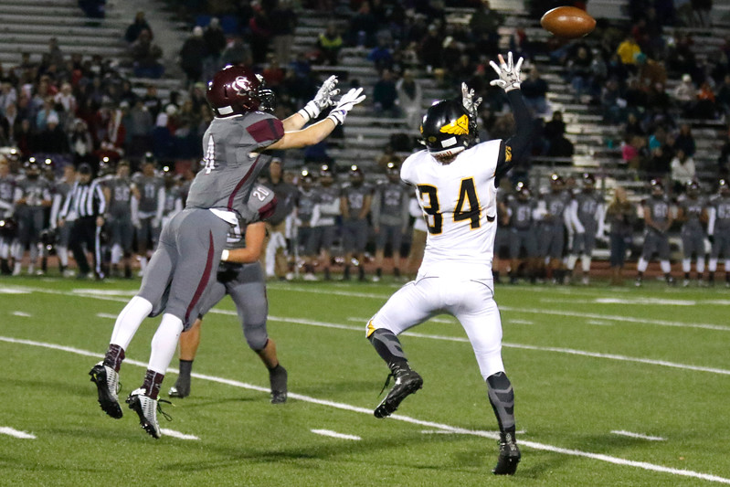 Thompson Valley's Warner Wolfgang (34) jumps to catch a pass as Silver Creek's Ashton Hubert (4) tries to intercept the ball on Thursday, Nov. 2, 2017 at Everly Montgomery Field in Longmont. (Lauren Cordova/Loveland Reporter-Herald)