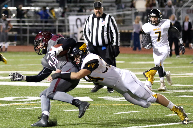 Thompson Valley's Caleb Burton (24) tackles Silver Creek's Andreik Knechtel (34) on Thursday, Nov. 2, 2017 at Everly Montgomery Field in Longmont. (Lauren Cordova/Loveland Reporter-Herald)