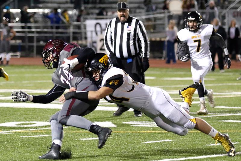 Thompson Valley's Caleb Burton (24) tackles Silver Creek's Andreik Knechtel (34) on Thursday, Nov. 2, 2017 at Everly Montgomery Field in Longmont. (Lauren Cordova/Loveland Reporter-Herald)