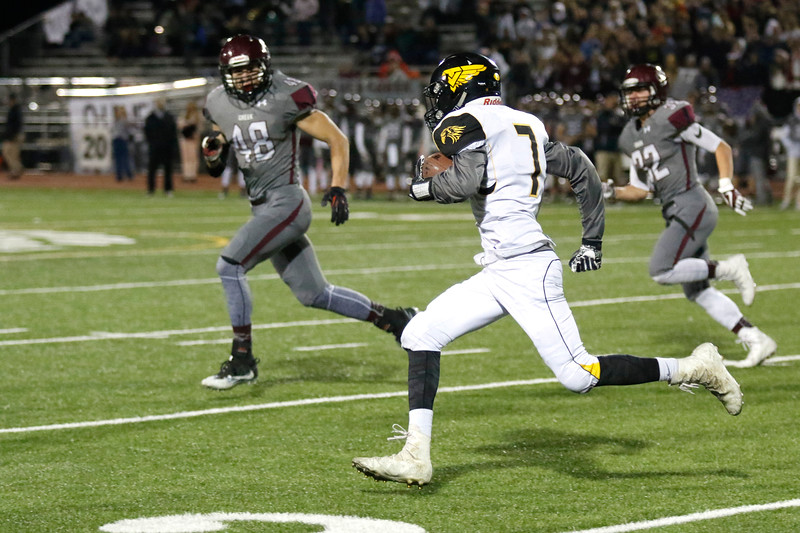 Thompson Valley's Jack Dyken (7) runs the ball past the 20-yard line as Silver Creek's Trevor Riters (48) and Brandon Harper (32) try and stop him on Thursday, Nov. 2, 2017 at Everly Montgomery Field in Longmont. (Lauren Cordova/Loveland Reporter-Herald)