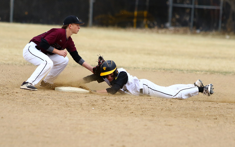 Thompson Valley's Austin Sobraske slides in safely witih a  stolen base as Silver Creek shortstop Spencer Rich is late with the tag in Thursday's game at Constantz Field. Javon Harris/Reporter-Herald