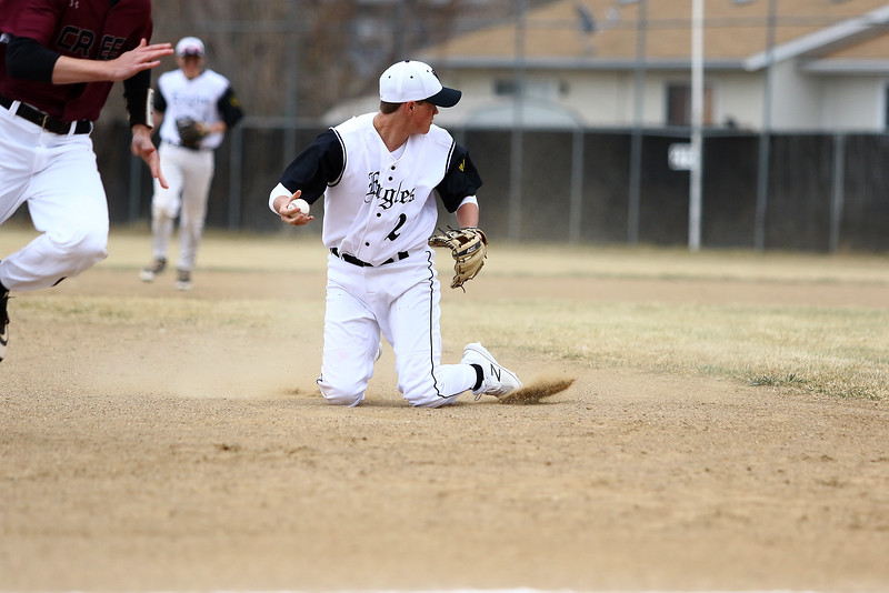 Thompson Valley third baseman Aidan Schultz tries to get a grip on the ball after making a stop in Thursday's game with Silver Creek at Constantz Field. Javon Harris/Reporter-Herald