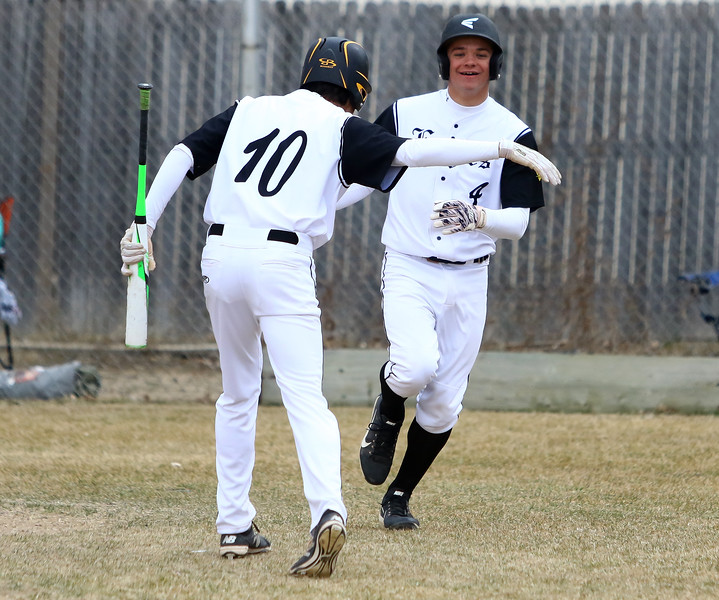 Thompson Valley's Adrian Juarez (10) congratulates Cameron Nellor after scoring on a base hit in the first inning of Thusday's game with Silver Creek at Constantz Field. Javon Harris/Reporter-Herald