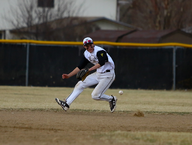 Thompson Valley shortstop Austin Sobraske goes for a grounder during Thursday's game  with Silver Creek at Constantz Field. Javon Harris/Reporter-Herald