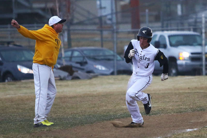 Thompson Valley coach Jay Denning waves home Jarrett Riehl, who scored on a doubel by Jayden Raabe in the fourth inning of Thusday's game with Silver Creek at Constantz Field. Javon Harris/Reporter-Herald