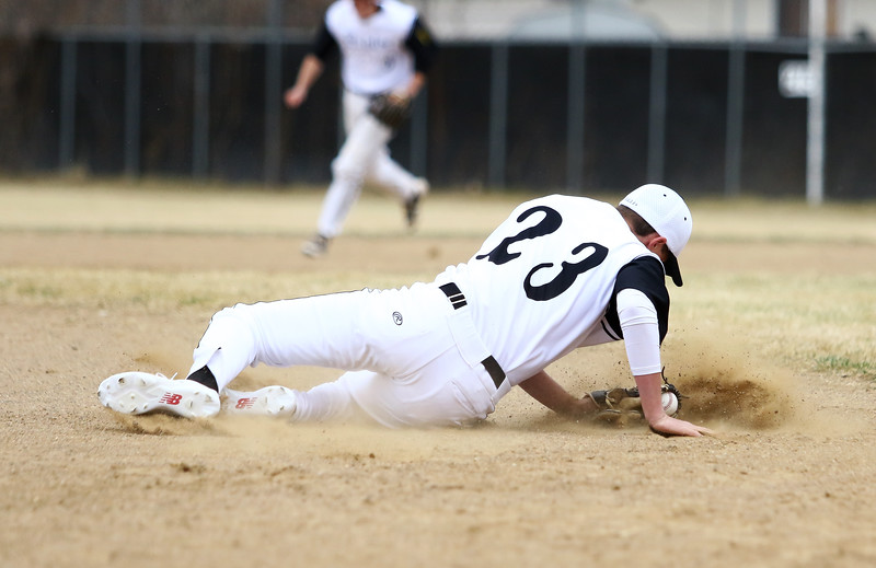 Thompson Valley third baseman Aidan Schultz goes to the ground to field a ball during Thursday's game with Silver Creek at Constantz Field. Javon Harris/Reporter-Herald