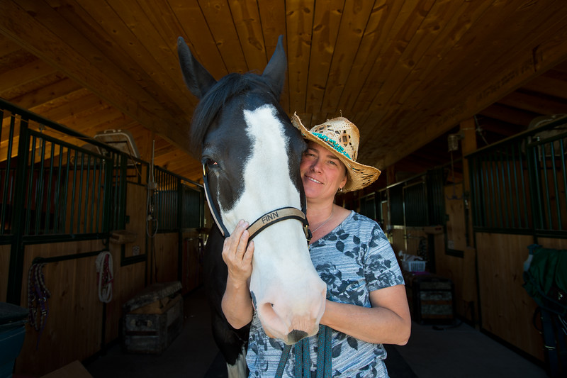 "Sara Martinelli with her horse Finn, a North American Spotted Draft Horse, at Three Leaf Farm in Lafayette. Martinelli was involved with the launch of a new website directory for the Boulder County Horse Association which will make it easier for others to get involved with the equestrian community in Boulder County. <br /> More photos:  <a href=""http://www.dailycamera.com"">http://www.dailycamera.com</a><br /> (Autumn Parry/Staff Photographer)<br /> June 15, 2016"