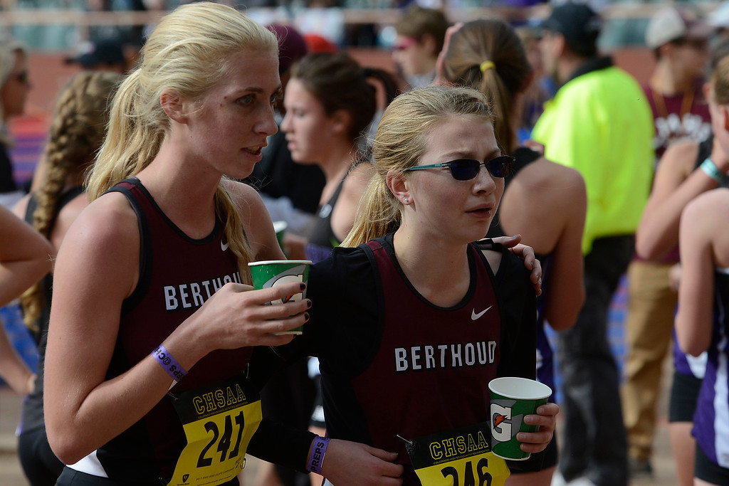 . Berthoud\'s Cailey Archer puts her arm around Ellie Sundheim at the state cross country championships on Oct. 28, 2017 at Norris Penrose Event Center in Colorado Springs. (Sean Star/Loveland Reporter-Herald)