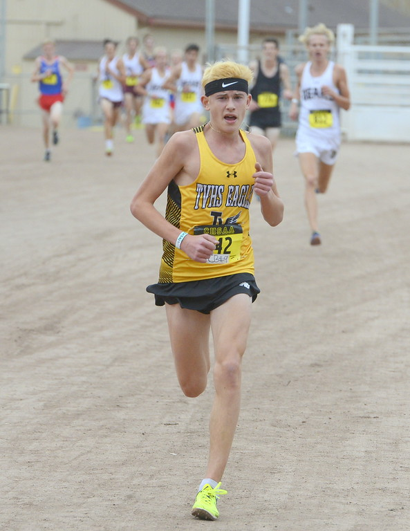 . Thompson Valley\'s Dylan Schubert heads toward a 13th place finish in the 4A boys state cross country championship on Saturday in Colorado Springs.