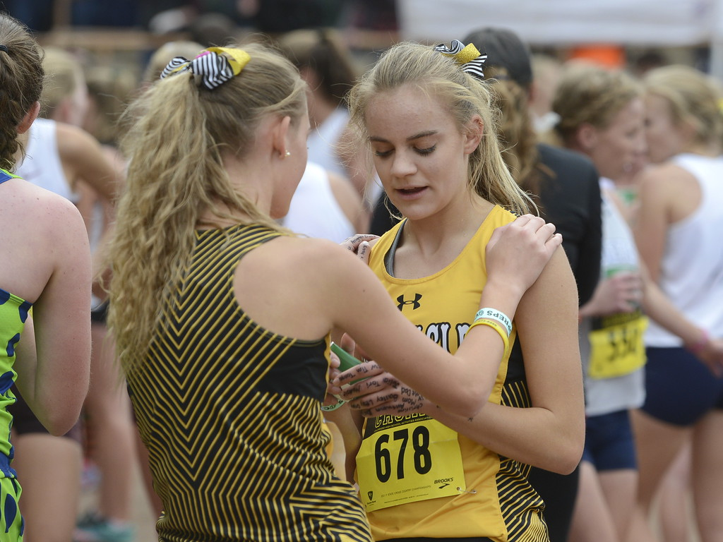 . Thompson Valley\'s Julia Lundgren, left, embraces teammate Kenadi Krueger after the 4A girls state cross country championship on Saturday in Colorado Springs.