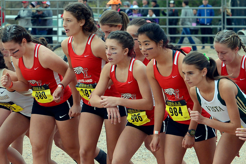 Members of the Loveland girls cross country team get ready for the start of the 2017 5A state championship on Oct. 28, 2017 at Norris Penrose Event Center in Colorado Springs. (Sean Star/Loveland Reporter-Herald)