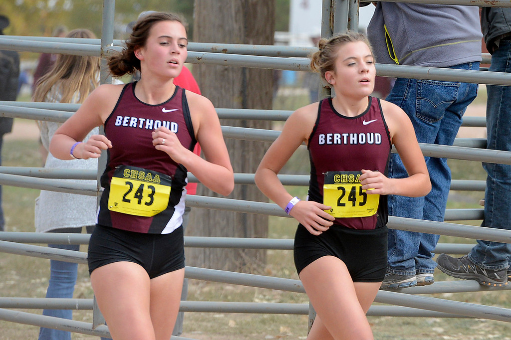. Berthoud\'s  Julianne Evans Dennison, left, and Alex Schultz compete at the state cross country championships on Oct. 28, 2017 at Norris Penrose Event Center in Colorado Springs. (Sean Star/Loveland Reporter-Herald)