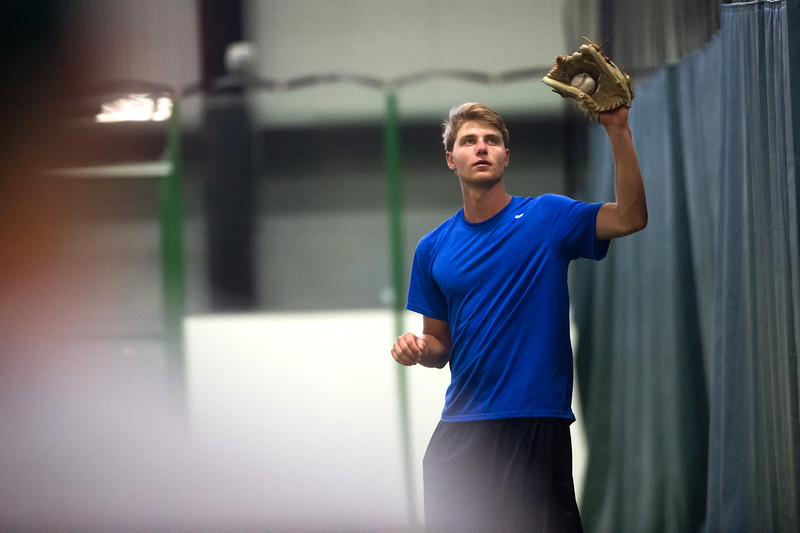 "Kyle Leahy catches the ball from a teammate during a training session for the members of the Superior Roughriders collegiate baseball team at Sport Stable in Superior on Thursday.<br /> More photos:  <a href=""http://www.dailycamera.com"">http://www.dailycamera.com</a><br /> (Autumn Parry/Staff Photographer)<br /> June 16, 2016"