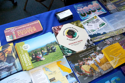 Tables such as UC Santa Cruz's had various forms of informational and promotional materials. (Shaun Walker -- The Times-Standard)