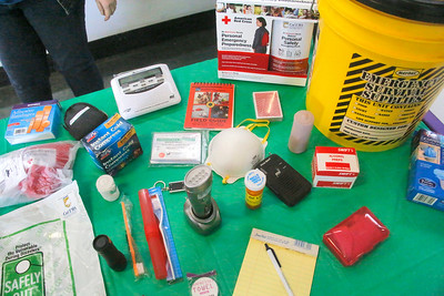 Survival and other items sit on a table at the Tsunami Preparedness and Health Fair. (Shaun Walker -- The Times-Standard)