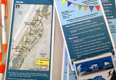 Information on evacuation routes and reacting to tsunamis sits near the front door. (Shaun Walker -- The Times-Standard)