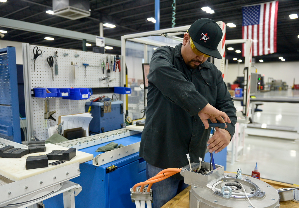 . Mario Salazar assembles a HD Plus electric motor at UQM Technologies, 4120 Specialty Pl., Friday morning. To view more photos visit timescall.com. Lewis Geyer/Staff Photographer Feb. 16, 2018