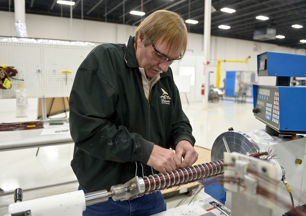 . Steve Corcilius assembles winding coils for a HD Plus electric motor at UQM Technologies, 4120 Specialty Pl., Friday morning. To view more photos visit timescall.com. Lewis Geyer/Staff Photographer Feb. 16, 2018
