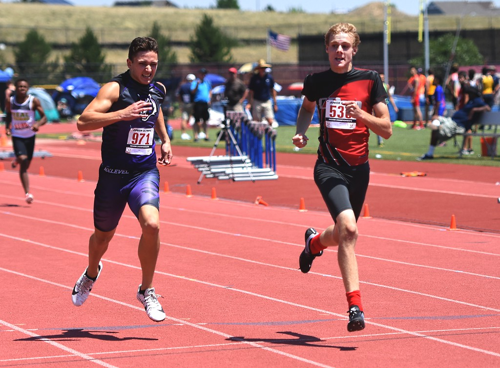 . CDm Elite\'s Andrew Muncy competes in the 13-14 boys 400-meter dash during the USATF Region 10 Championships on Saturday at Legacy Stadium in Aurora.