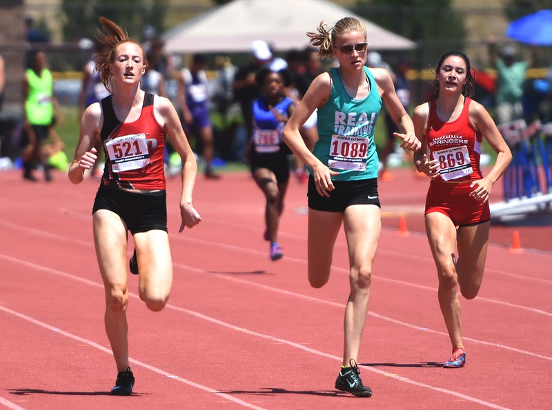 R.E.A.L. Training's Taylor James edges CDm Elite's Sophia Lindauer for the win during prelims at the USATF Region 10 Championships on Saturday at Legacy Stadium in Aurora.