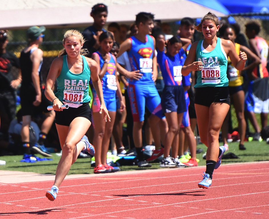 . R.E.A.L. Training\'s Erin Carroll takes the baton during the USATF Region 10 Championships on Saturday at Legacy Stadium in Aurora.