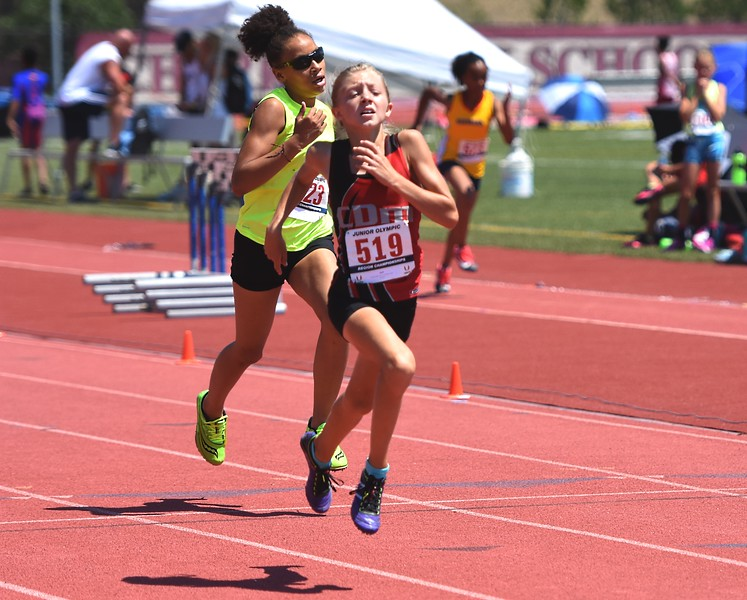 CDm Elite's Paige Farnam competes in the 11-12 girls 400-meter dash during the USATF Region 10 Championships on Saturday at Legacy Stadium in Aurora.