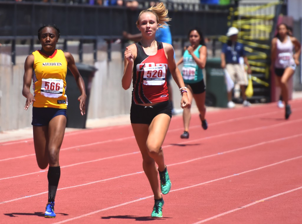 . CDm Elite\'s Abbey Glynn wins her preliminary heat of the 17-18 girls 400-meter dash during the USATF Region 10 Championships on Saturday at Legacy Stadium in Aurora.