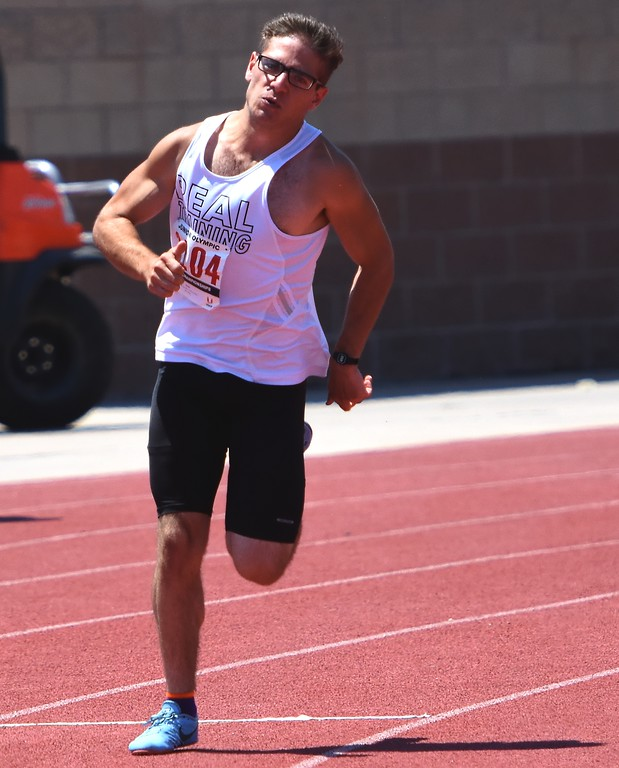 . R.E.A.L. Training\'s Alex Herman competes in the 17-18 boys 400-meter dash during the USATF Region 10 Championships on Saturday at Legacy Stadium in Aurora.