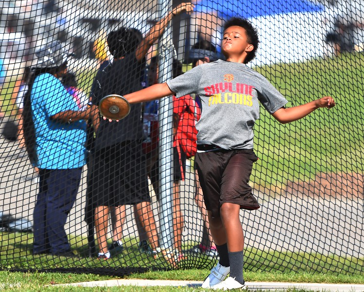 CDm Elite's JJ Davis competes in the 11-12 boys discus during the USATF Region 10 Championships on Saturday at Legacy Stadium in Aurora.