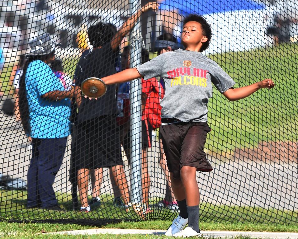 . CDm Elite\'s JJ Davis competes in the 11-12 boys discus during the USATF Region 10 Championships on Saturday at Legacy Stadium in Aurora.