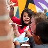 "April Morales, 9, helps paint a mural created by internationally renowned artist Rafael López, in replacement of the BotStories mural on 13th St. and Arapahoe Ave., in Boulder on Friday.<br /> More photos:  <a href=""http://www.dailycamera.com"">http://www.dailycamera.com</a><br /> (Autumn Parry/Staff Photographer)<br /> September 30, 2016"