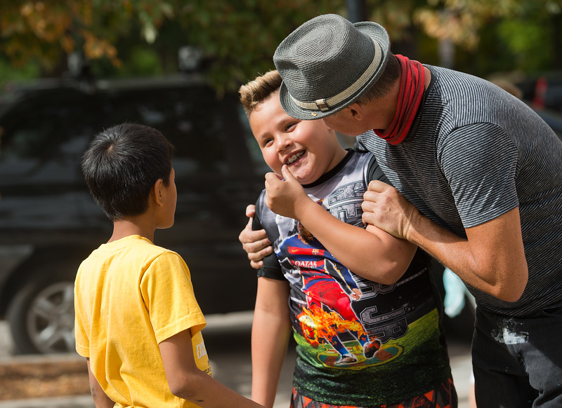 "Caesar Lopez, 9, receives a hug from artist Rafael López after painting a mural in Boulder on Friday. López used inspiration from the children to create the new mural that replaced Botstories on 13th St. and Arapahoe Ave.<br /> More photos:  <a href=""http://www.dailycamera.com"">http://www.dailycamera.com</a><br /> (Autumn Parry/Staff Photographer)<br /> September 30, 2016"