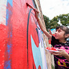 "Alma Garcia, 9, helps paint a mural created by internationally renowned artist Rafael López, in replacement of the BotStories mural on 13th St. and Arapahoe Ave., in Boulder on Friday.<br /> More photos:  <a href=""http://www.dailycamera.com"">http://www.dailycamera.com</a><br /> (Autumn Parry/Staff Photographer)<br /> September 30, 2016"