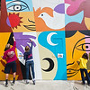 "From left to right, CU Volunteer Logan Swartz, Jen Row and Neva Woodson, 9, help paint a mural created by internationally renowned artist Rafael López, in replacement of the BotStories mural on 13th St. and Arapahoe Ave., in Boulder on Friday.<br /> More photos:  <a href=""http://www.dailycamera.com"">http://www.dailycamera.com</a><br /> (Autumn Parry/Staff Photographer)<br /> September 30, 2016"