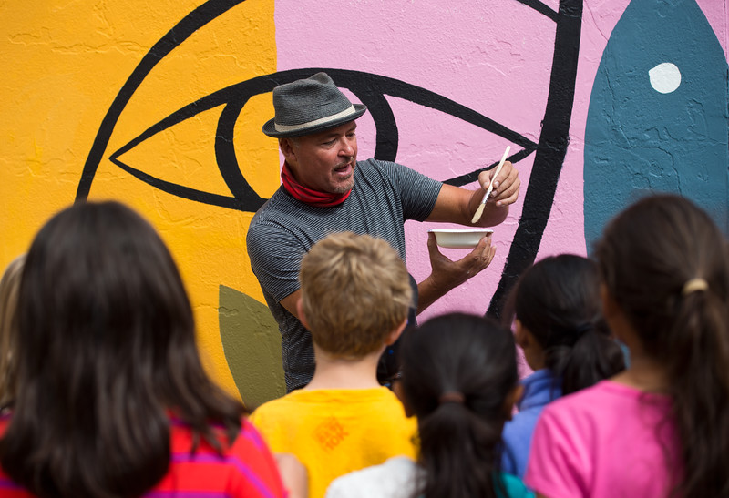 "Internationally renowned artist Rafael López gives instructions on how to paint the mural to University Hill Elementary students in Boulder on Friday.<br /> More photos:  <a href=""http://www.dailycamera.com"">http://www.dailycamera.com</a><br /> (Autumn Parry/Staff Photographer)<br /> September 30, 2016"