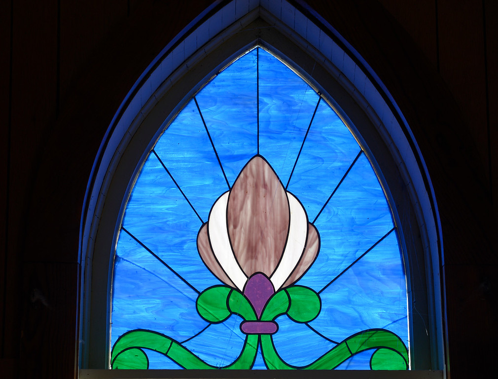 . WARD, CO - SEPTEMBER 13, 2018: A stained glass window at Union Congregational Church of Ward Sept. 13. A groundbreaking will take place Sunday to herald a $50,000 renovation for the 122-year-old church, the same one whose belltower is featured in a painting by Georgia O\'Keefe.(Photo by Lewis Geyer/Staff Photographer)