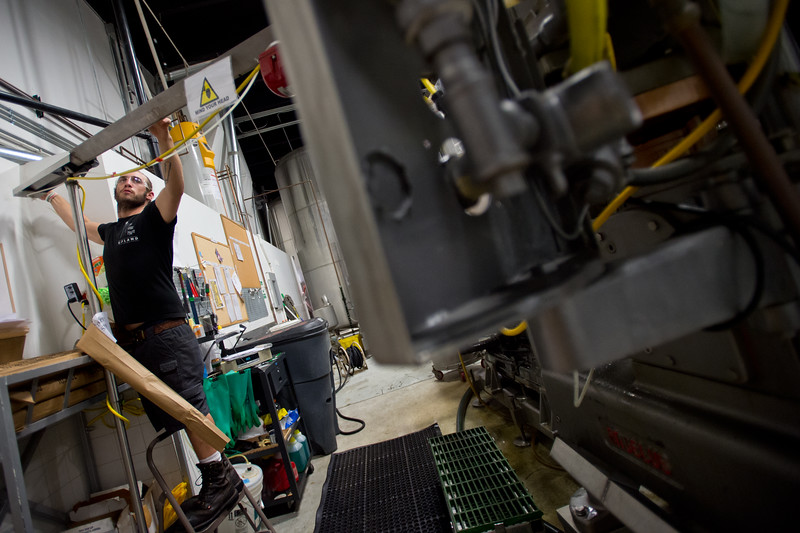 "Shane Lyons, a back-up filler operator, adds aluminum can tops into a seamer machine which seals the cans of beer at Upslope Brewing Company in Boulder on Thursday.<br /> More photos:  <a href=""http://www.dailycamera.com"">http://www.dailycamera.com</a><br /> (Autumn Parry/Staff Photographer)<br /> July 20, 2016"